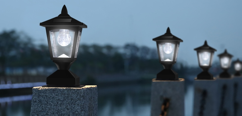 there are 5 solar cap lights near a lake