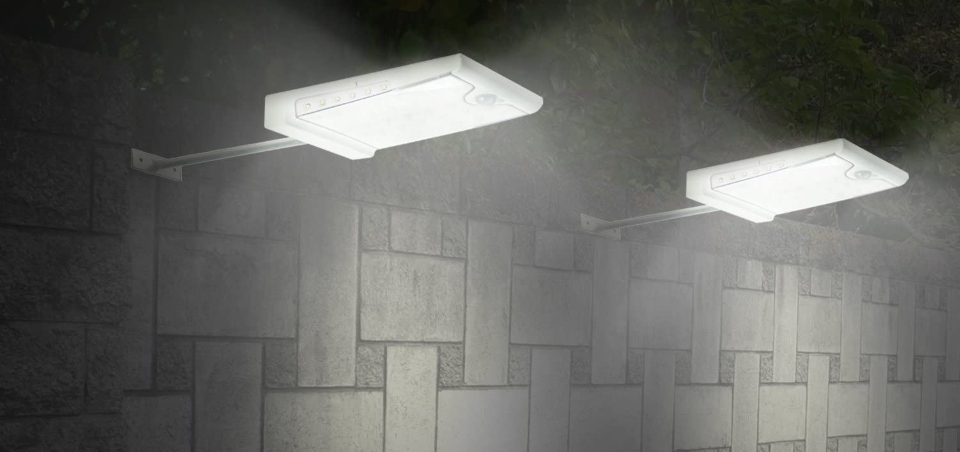 there are two solar gutter lights on one wall