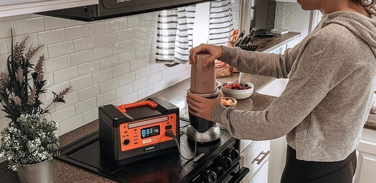 a woman using a solar generator in the kitchen